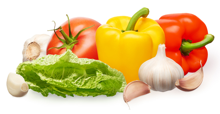 Whole fresh red tomato with green leaf, yellow and red bell peppers, green salad and garlic with cloves isolated on white background