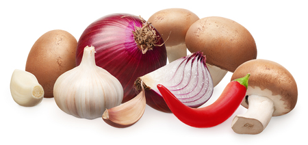 Whole fresh royal champignon mushrooms, unpeeled red onion with slice, garlic with cloves and red chili pepper isolated on white background