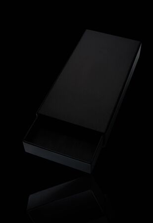 Open empty slick black gift box with reflection on black background