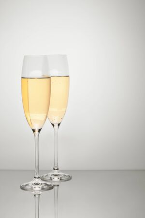 Two glasses of champagne with reflection isolated on white background. Clipping path included.