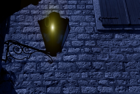 Street lantern lit against evening sky photo