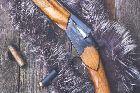reloading: Hunting rifle on a wooden background. Stock Photo