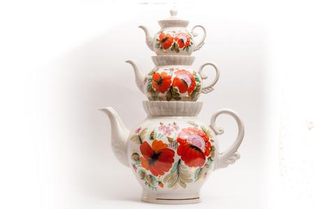 kettles: Sobre un fondo blanco representa teteras de té para el té Foto de archivo