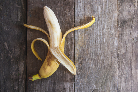 gritty: Banana on a background of a wooden framework with treated skin