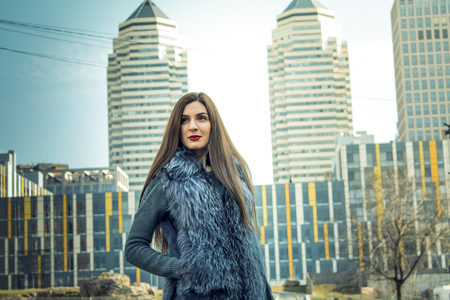 megapolis: Street photosession of the girl, in a big city, in different places. Portraits on a background of modern and retro buildings