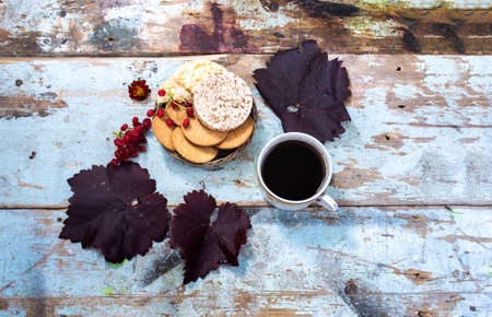 Still life of baked goods on a dark background, made from old vintage boards 写真素材