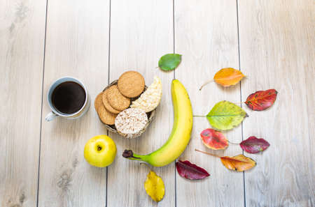 Breakfast, on the background of light oak boards, with elements of autumn decor Stock fotó