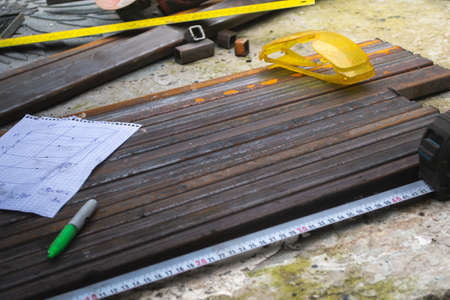 Machining square metal pipes, outdoors. There are also additional auxiliary tools in the frame