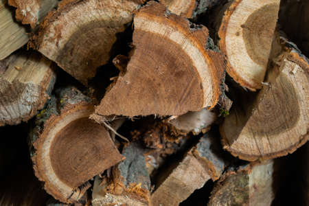 Image of sawn wood, stacked in a pile and split in small segments