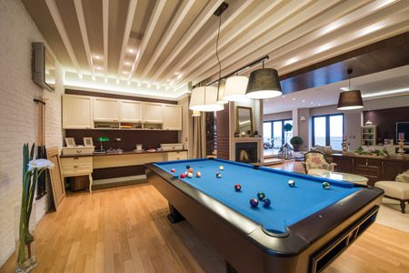 snooker tables: Interior of a luxury living room with pool table Stock Photo