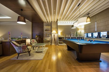 Interior of a luxury living room with pool table Stockfoto