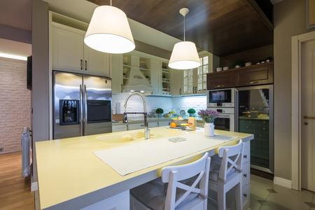lightings: Interior of a specious modern kitchen