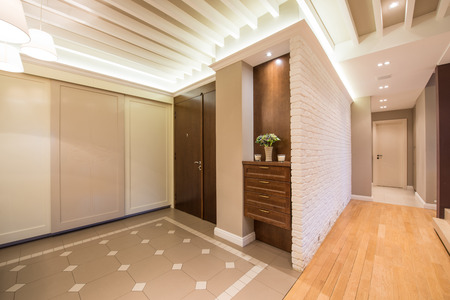anteroom: Spacious anteroom interior in warm tones and modern ceiling lights