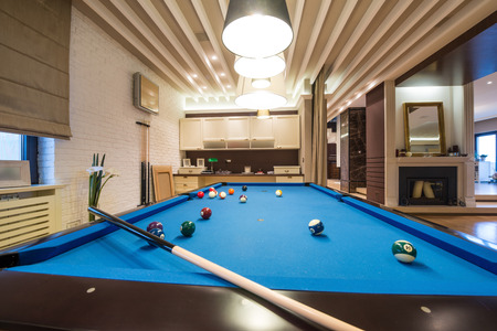 Billiard table in luxury living room 스톡 콘텐츠