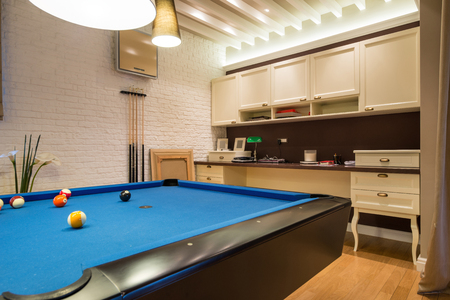 snooker room: Interior of a living room with pool table Stock Photo