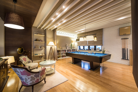 Interior of a luxury living room with billiard table