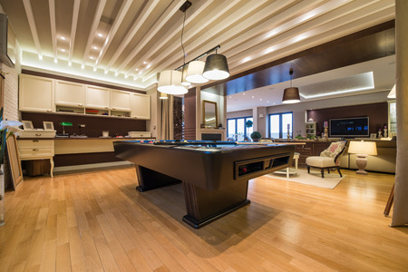 snooker room: Interior of a luxury living room with pool table Stock Photo