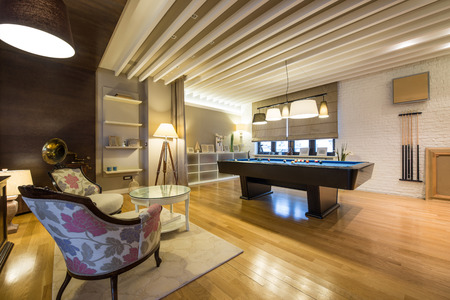 ceiling lamps: Interior of a luxury living room with billiard table