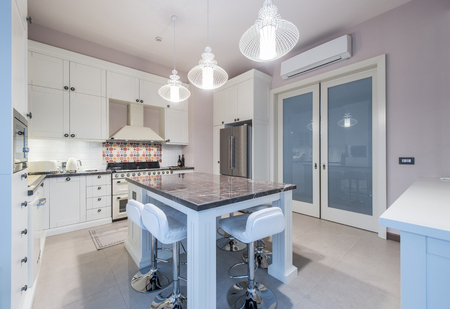 kitchen island: Kitchen Interior with Island, Sink, Cabinets,Tiled Floors in New Luxury Home