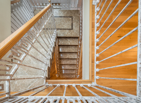Marble stairs with wrought iron stair railingin in luxury villa 스톡 콘텐츠