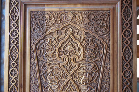 �arved wooden door. Fragment. Example of a traditional wood-carving in Uzbekistan. Stock Photo