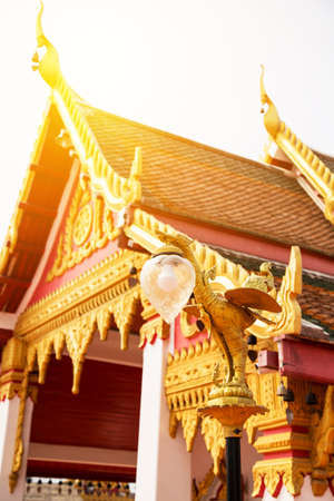 Thai traditional golden swan lamp in the temple