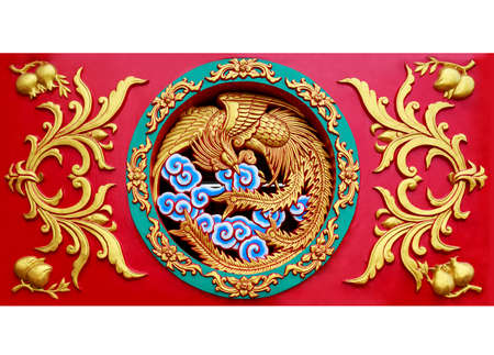 Close up carved phoenix on the wall sculpture in Chinese temple