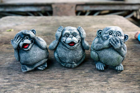 Three monkey,close up of hand small statues with the concept of see no evil, hear no evil and speak no evil. Stock Photo