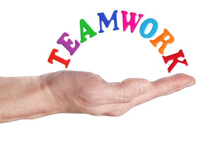 teaming: Word of color childrens letters on hand  Stock Photo