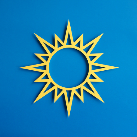 Symbol made of paper with blue background photo