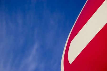Fragment of No Entry sign on blue sky photo