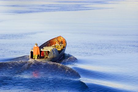 boater: Lone Boater floating old dory Stock Photo