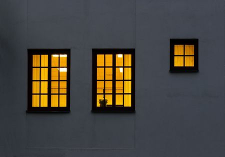 Look through a windows from outside to inside. Lightened two large and one half size windows Stock Photo - 739804