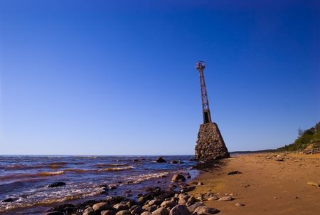 Old abandoned lighthouse already in the water photo