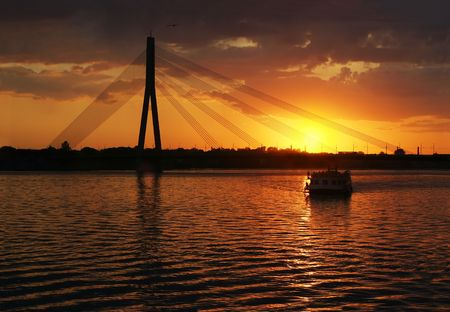nightime: Riga suspension bridges silhouette in sunset