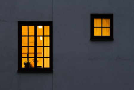 outside of house: Look through a windows from outside to inside. Lightened one large and half size windows Stock Photo