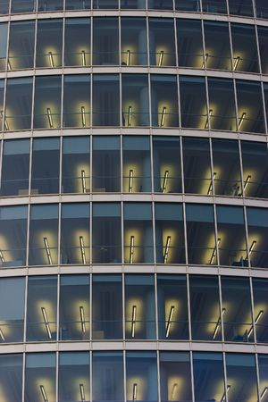 Illuminated windows of corporate office building. photo