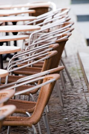 Outdoor cafe chairs and tables on a rainy day Stock Photo - 3011236