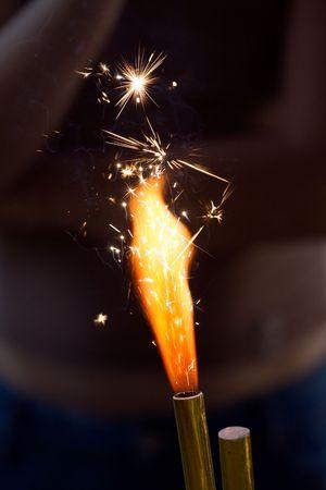 branching: Burning birthday cake sparkler. Flame with branching white sparks.