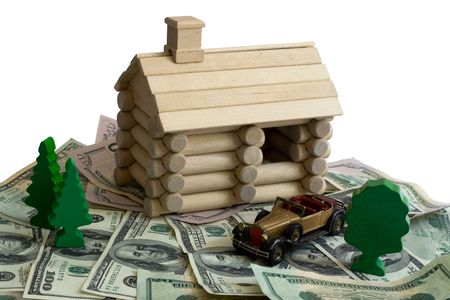 Miniature Log House building model and money dollar bills background photo