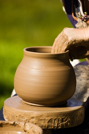 Potters hands working on new pot