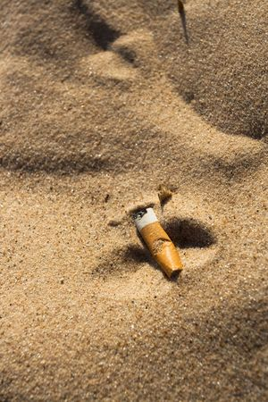 Cigarette butt in sand. Litter on the beach Stock Photo - 3168823