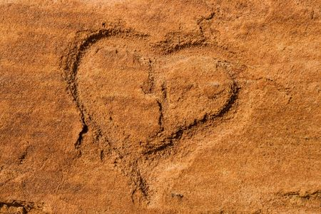 scraped: Shape of an heart scraped into the red sandstone