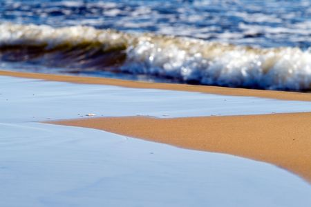 Beach sand and sea water waves background Stock Photo - 3332362