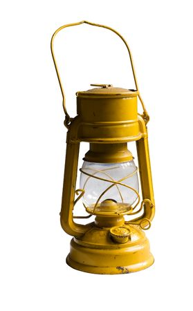 Yellow Kerosene lamp or paraffin lamp isolated on white. Clipping path included photo