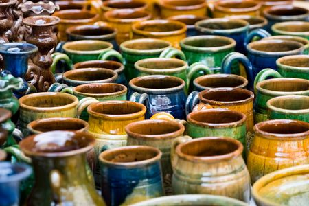 glazed: Glazed colourful pottery products ready for sale Stock Photo