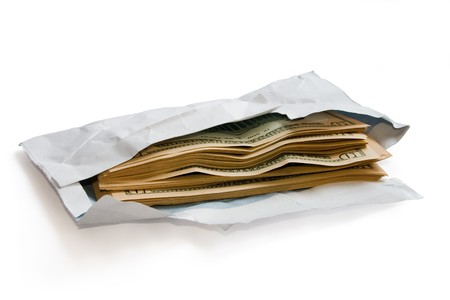 extortion: Stack of dolars in open envelope isolated on white. Stock Photo
