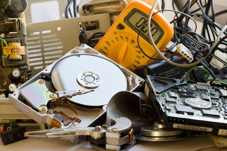 discarded metal: Pile of Old computer parts and hard disks Stock Photo