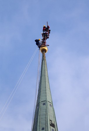 steeplejack: Many Industrial alpinists working at church tower Stock Photo