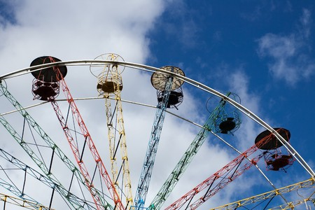 sigulda: Multicoloured Ferris wheel against blue sky in Sigulda, Latvia Stock Photo